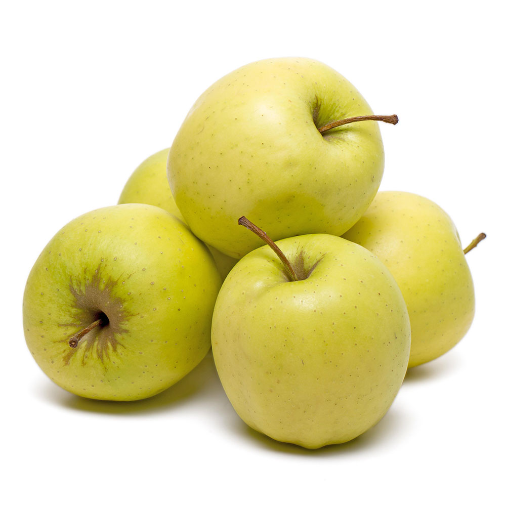 MANZANA GOLDEN close up view of pile yellow apples isolated on white background 1000p